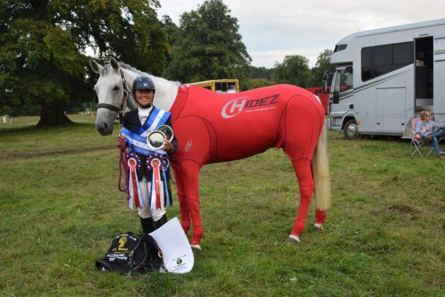 Flo, horse care apprentice, winning shows